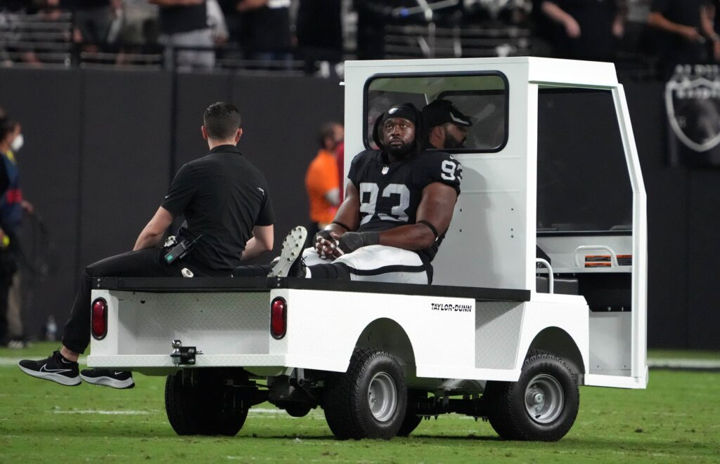 Sep 13, 2021; Paradise, Nevada, USA; Las Vegas Raiders defensive tackle Gerald McCoy (93) is taken to the locker room after suffering an apparent injury against the Baltimore Ravens during the second half at Allegiant Stadium. Mandatory Credit: Kirby Lee-USA TODAY Sports