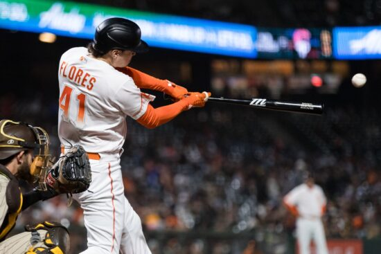 Sep 14, 2021; San Francisco, California, USA; San Francisco Giants second baseman Wilmer Flores (41) hits a double against the San Diego Padres in the eighth inning at Oracle Park. Mandatory Credit: John Hefti-USA TODAY Sports