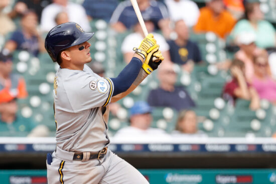 Sep 15, 2021; Detroit, Michigan, USA;  Milwaukee Brewers third baseman Luis Urias (2) hits a single in the ninth inning against the Detroit Tigers at Comerica Park. Mandatory Credit: Rick Osentoski-USA TODAY Sports