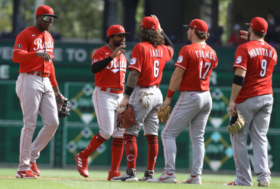 Sep 16, 2021; Pittsburgh, Pennsylvania, USA;  Cincinnati Reds players celebrate after defeating the Pittsburgh Pirates at PNC Park. The Reds shutout the Pirates 1-0. Mandatory Credit: Charles LeClaire-USA TODAY Sports