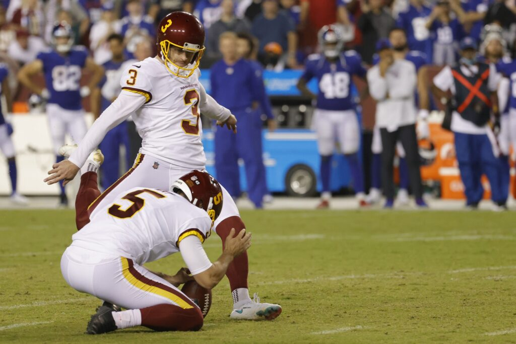 Sep 16, 2021; Landover, Maryland, USA; Washington Football Team place kicker Dustin Hopkins (3) makes a game winning field goal on the final play against the New York Giants in the fourth quarter at FedExField. Mandatory Credit: Geoff Burke-USA TODAY Sports