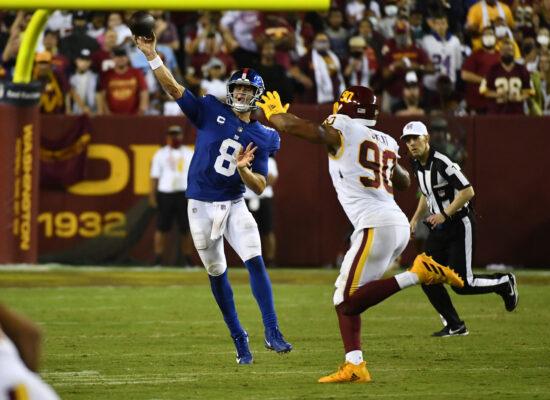 Sep 16, 2021; Landover, Maryland, USA; New York Giants quarterback Daniel Jones (8) throws a pass over Washington Football Team defensive end Montez Sweat (90) during the second half at FedExField. Mandatory Credit: Brad Mills-USA TODAY Sports