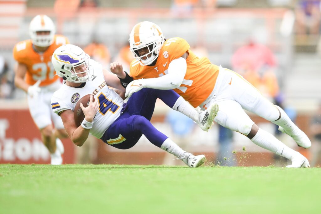 Tennessee linebacker Aaron Willis (41) tackles Tennessee Tech quarterback Drew Martin (4) during an NCAA college football game between the Tennessee Volunteers and Tennessee Tech in Knoxville, Tenn. on Saturday, September 18, 2021.  Tennvstt0918 3010