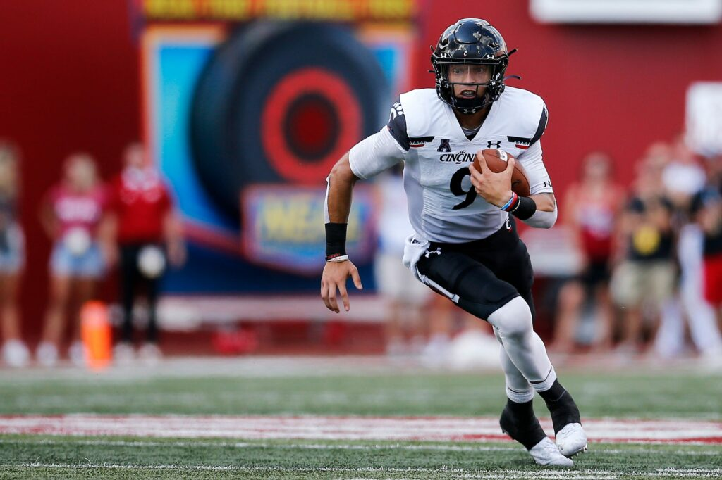 Cincinnati Bearcats quarterback Desmond Ridder (9) runs through a hole in the fourth quarter of the NCAA football game between the Indiana Hoosiers and the Cincinnati Bearcats at Memorial Stadium in Bloomington, Ind., on Saturday, Sept. 18, 2021. The Bearcats won 38-24.  Cincinnati Bearcats At Indiana Hoosiers Football