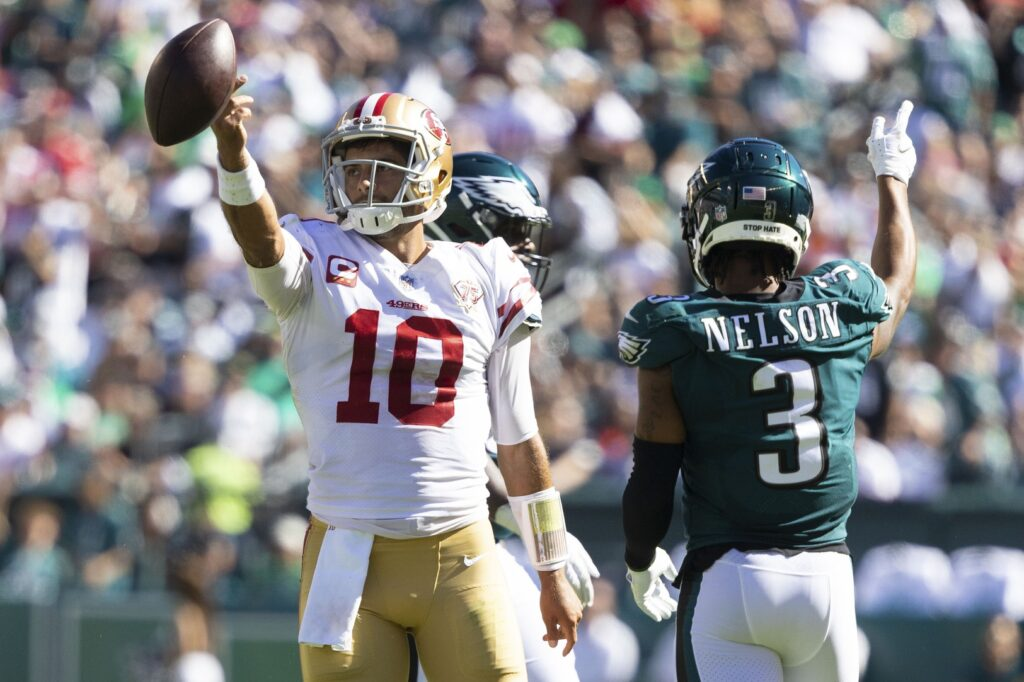 Sep 19, 2021; Philadelphia, Pennsylvania, USA; San Francisco 49ers quarterback Jimmy Garoppolo (10) reacts to his first down run in front of Philadelphia Eagles cornerback Steven Nelson (3) during the fourth quarter at Lincoln Financial Field. Mandatory Credit: Bill Streicher-USA TODAY Sports