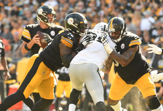 Sep 19, 2021; Pittsburgh, Pennsylvania, USA;  Pittsburgh Steelers Chuckwuma Okorafor, left, and guard Trai Turner slow down Las Vegas Raiders defensive end Maxx Crosby as quarterback Ben Roethlisberger throws a fourth quarter touchdown at Heinz Field. The Raiders won the game 26-17. Mandatory Credit: Philip G. Pavely-USA TODAY Sports