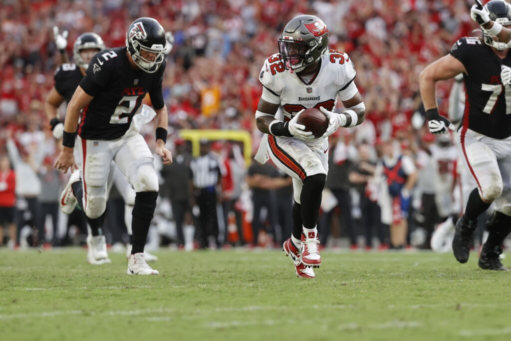 Sep 19, 2021; Tampa, Florida, USA;Tampa Bay Buccaneers safety Mike Edwards (32) runs the ball back for a touchdown  against the Atlanta Falcons  during the second half at Raymond James Stadium. Mandatory Credit: Kim Klement-USA TODAY Sports
