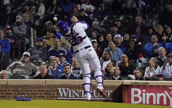 Sep 22, 2021; Chicago, Illinois, USA; Chicago Cubs catcher Austin Romine (25) makes a catch on Minnesota Twins third baseman Josh Donaldson (not pictured) during the eighth inning at Wrigley Field. Mandatory Credit: David Banks-USA TODAY Sports