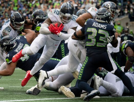 Tennessee Titans running back Derrick Henry (22) scores a touchdown past Seattle Seahawks defenders during the fourth quarter to tie the game at Lumen Field Sunday, Sept. 19, 2021 in Seattle, Wash.Nas Titans Seahawks 024