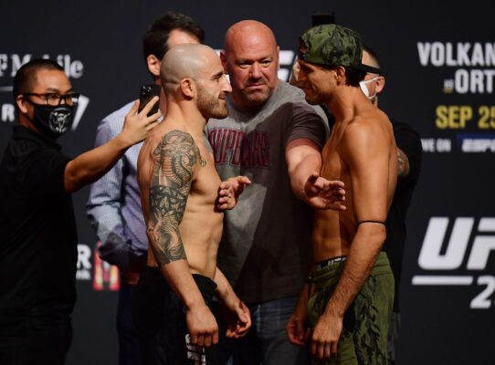 Sep 24, 2021; Las Vegas, Nevada, USA; Alexander Volkanovski and Brian Ortega meet face to face as UFC president Dana White separates during weigh-ins for UFC 266 at Park Theater. Mandatory Credit: Gary A. Vasquez-USA TODAY Sports