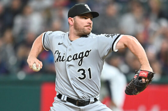 Sep 24, 2021; Cleveland, Ohio, USA; Chicago White Sox relief pitcher Liam Hendriks (31) throws a pitch during the ninth inning against the Cleveland Indians at Progressive Field. Mandatory Credit: Ken Blaze-USA TODAY Sports