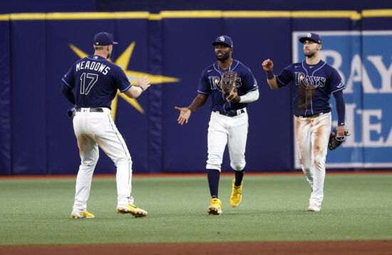 Sep 24, 2021; St. Petersburg, Florida, USA;Tampa Bay Rays left Austin Meadows (17), right fielder Randy Arozarena (56) and center fielder Kevin Kiermaier (39) celebrate as they beat the Miami Marlins at Tropicana Field. Mandatory Credit: Kim Klement-USA TODAY Sports