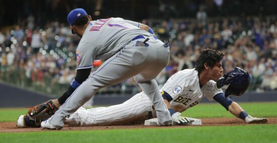Milwaukee Brewers left fielder Christian Yelich (22) beats a tag at third by New York Mets Jonathan Villar (1) after hitting a triple during the fifth inning of their game against the against the against the New York Mets Friday, September 24, 2021 at Miller Park in Milwaukee, Wis.MARK HOFFMAN/MILWAUKEE JOURNAL SENTINELMjs Brewers25 25 Jpg Brewers25