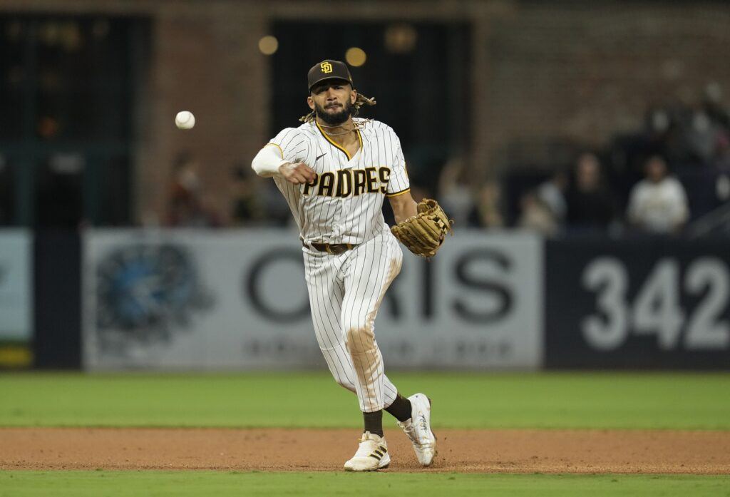 Sep 24, 2021; San Diego, California, USA;  San Diego Padres shortstop Fernando Tatis Jr. (23) throws to first base against the Atlanta Braves during the sixth inning at Petco Park. Mandatory Credit: Ray Acevedo-USA TODAY Sports