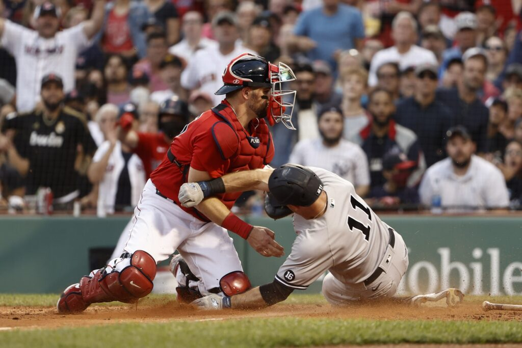 Sep 25, 2021; Boston, Massachusetts, USA; New York Yankees left fielder Brett Gardner (11) is tagged out at home by Boston Red Sox catcher Christian Vazquez (7) trying to score on a ground ball during the sixth inning at Fenway Park. Mandatory Credit: Winslow Townson-USA TODAY Sports