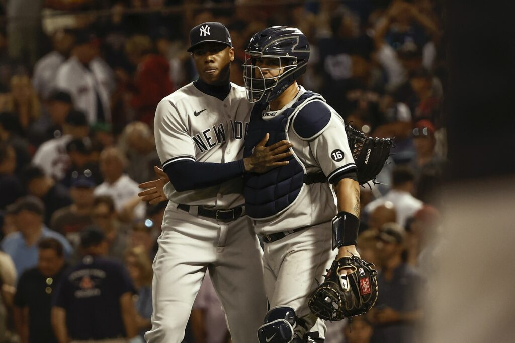 Sep 25, 2021; Boston, Massachusetts, USA; New York Yankees relief pitcher Aroldis Chapman (54) celebrates with catcher Gary Sanchez (24) after defeating the Boston Red Sox at Fenway Park. Mandatory Credit: Winslow Townson-USA TODAY Sports