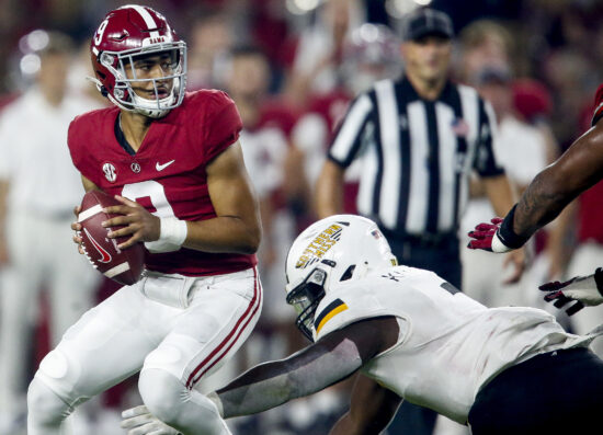 Sep 25, 2021; Tuscaloosa, Alabama, USA;  Alabama Crimson Tide quarterback Bryce Young (9) drops back to throw under pressure against the Southern Miss Golden Eagles during the first half at Bryant-Denny Stadium. Mandatory Credit: Gary Cosby-USA TODAY Sports