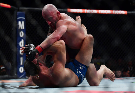 Sep 25, 2021; Las Vegas, Nevada, USA; Alexander Volkanovski pins Brian Ortega to the mat during UFC 266 at T-Mobile Arena. Mandatory Credit: Gary A. Vasquez-USA TODAY Sports