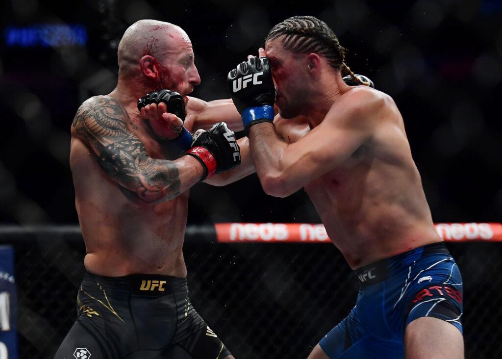 Sep 25, 2021; Las Vegas, Nevada, USA; Brian Ortega lands a hit against Alexander Volkanovski during UFC 266 at T-Mobile Arena. Mandatory Credit: Gary A. Vasquez-USA TODAY Sports