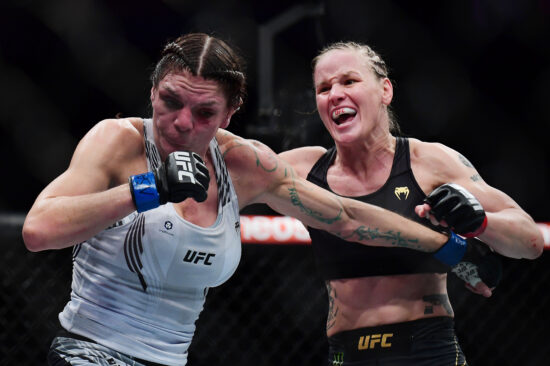 Sep 25, 2021; Las Vegas, Nevada, USA; Valentina Shevchenko moves in for a hit against Lauren Murphy during UFC 266 at T-Mobile Arena. Mandatory Credit: Gary A. Vasquez-USA TODAY Sports