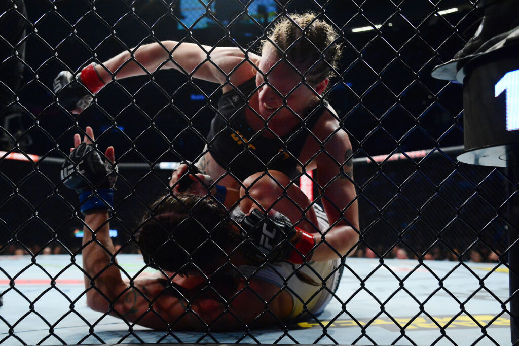 Sep 25, 2021; Las Vegas, Nevada, USA; Valentina Shevchenko pins Lauren Murphy and lands hits during UFC 266 at T-Mobile Arena. Mandatory Credit: Gary A. Vasquez-USA TODAY Sports