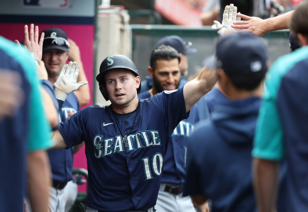 Sep 26, 2021; Anaheim, California, USA; Seattle Mariners center fielder Jarred Kelenic (10) celebrates with teammates after hitting a solo home run against the Los Angeles Angels in the seventh inning at Angel Stadium. Mandatory Credit: Kiyoshi Mio-USA TODAY Sports