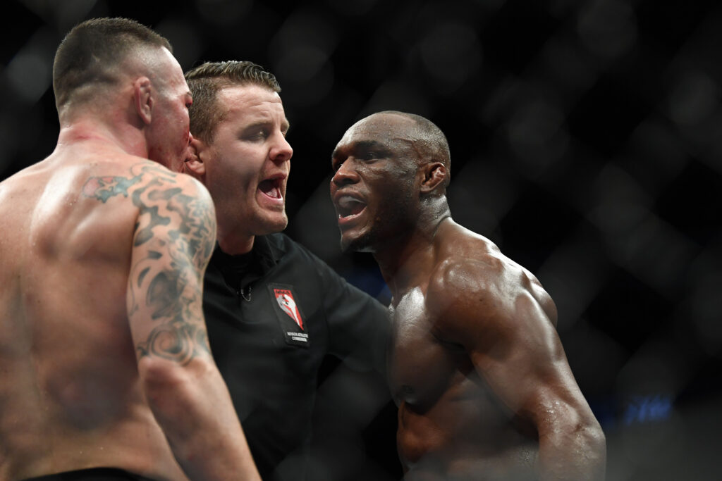 Dec 14, 2019; Las Vegas, NV, USA; Kamaru Usman (right) and Colby Covington (left) are separated by referee Marc Goddard during UFC 245 at T-Mobile Arena. Mandatory Credit: Stephen R. Sylvanie-USA TODAY Sports