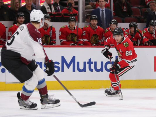 Dec 18, 2019; Chicago, IL, USA; Chicago Blackhawks right wing Patrick Kane (88) skates against Colorado Avalanche defenseman Nikita Zadorov (16) during the first period at the United Center. Mandatory Credit: Dennis Wierzbicki-USA TODAY Sports