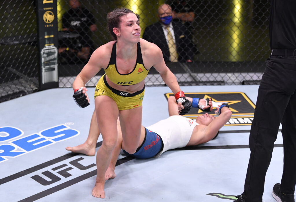 May 30, 2020; Las Vegas, NV, USA; Mackenzie Dern (red gloves) celebrates after her submission victory over Hannah Cifers (blue gloves) in their strawweight fight during UFC Fight Night.  Mandatory Credit: Jeff Bottari/Zuffa via USA TODAY Sports