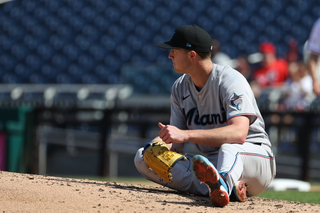 Sep 15, 2021; Washington, District of Columbia, USA; Miami Marlins starting pitcher Trevor Rogers (28) sits in the field after giving up an RBI single to Washington Nationals left fielder Lane Thomas (not pictured) in the fourth inning at Nationals Park. Mandatory Credit: Geoff Burke-USA TODAY Sports