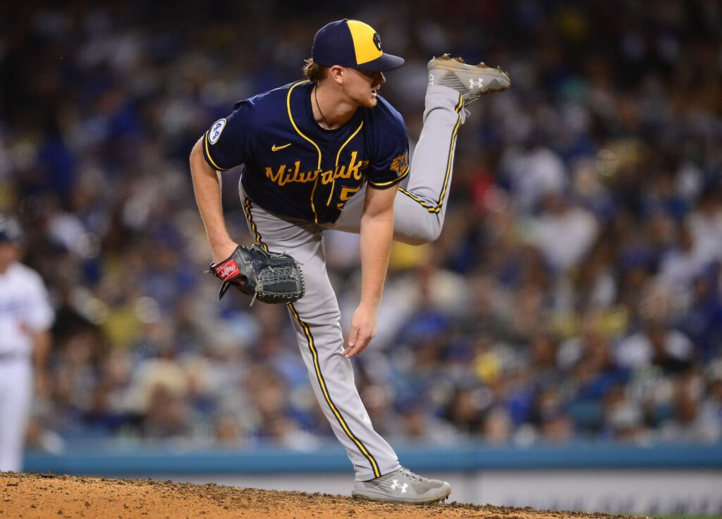 Oct 1, 2021; Los Angeles, California, USA; Milwaukee Brewers starting pitcher Eric Lauer (52) throws against the Los Angeles Dodgers during the fourth inning at Dodger Stadium. Mandatory Credit: Gary A. Vasquez-USA TODAY Sports