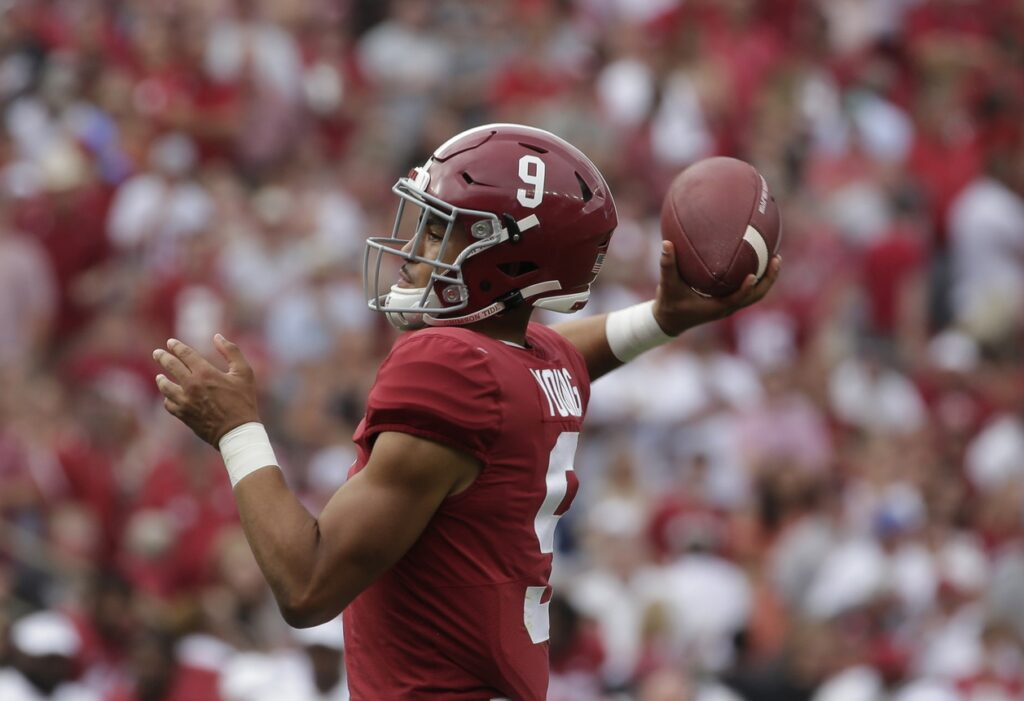 Oct 2, 2021; Tuscaloosa, Alabama, USA;  Alabama Crimson Tide quarterback Bryce Young (9) throws a pass for a touchdown against the Mississippi Rebels during the first half of an NCAA college football game at Bryant-Denny Stadium. Mandatory Credit: Butch Dill-USA TODAY Sports