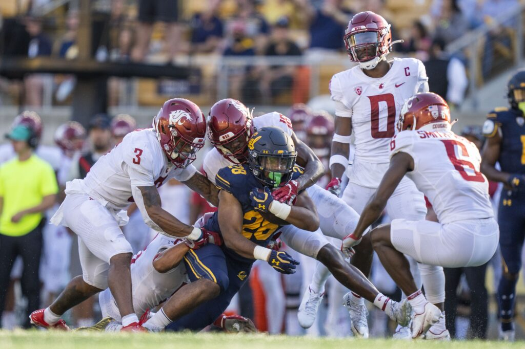 October 2, 2021; Berkeley, California, USA; California Golden Bears running back Damien Moore (28) is tackled by the Washington State Cougars during the fourth quarter at FTX Field at California Memorial Stadium. Mandatory Credit: Kyle Terada-USA TODAY Sports