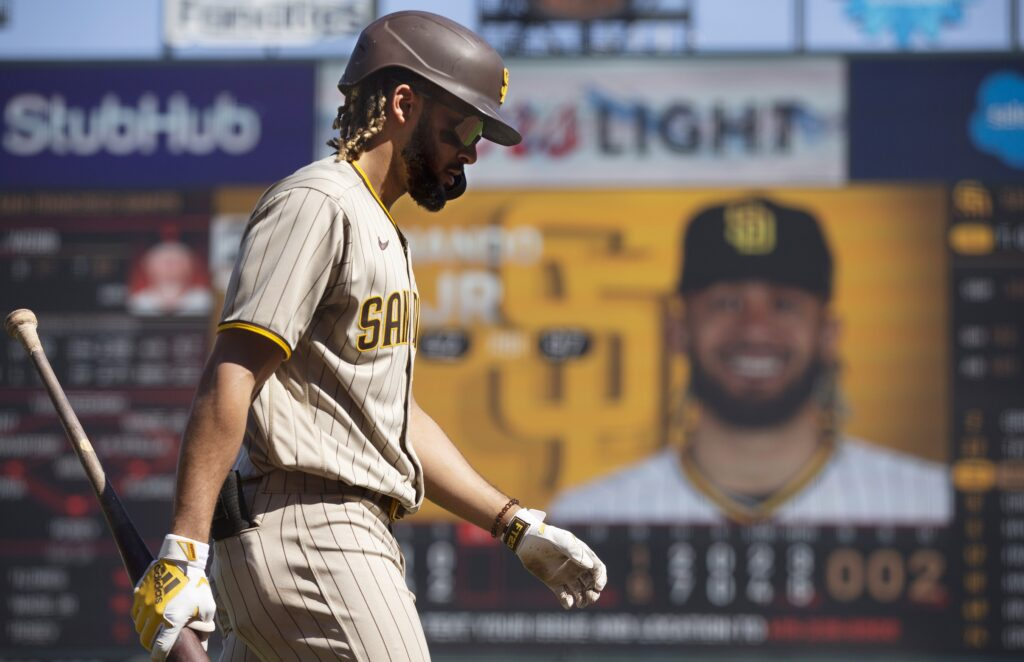Oct 3, 2021; San Francisco, California, USA; San Diego Padres shortstop Fernando Tatis Jr. (23) walks back to the dugout after striking out against San Francisco Giants starting pitcher Logan Webb (not pictured) during the sixth inning at Oracle Park. Mandatory Credit: D. Ross Cameron-USA TODAY Sports