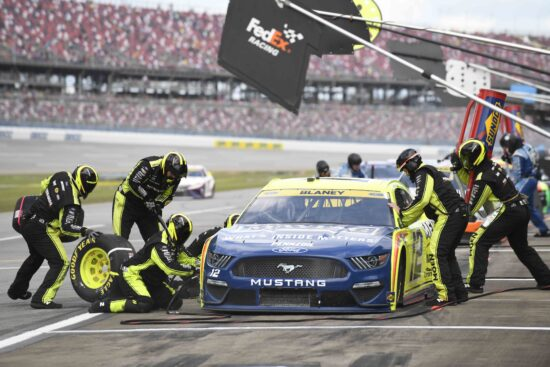 Oct 4, 2021; Talladega, Alabama, USA; NASCAR Cup Series driver Ryan Blaney (12) in pit lane during the YellaWood 500 at Talladega Superspeedway. Mandatory Credit: Adam Hagy-USA TODAY Sports