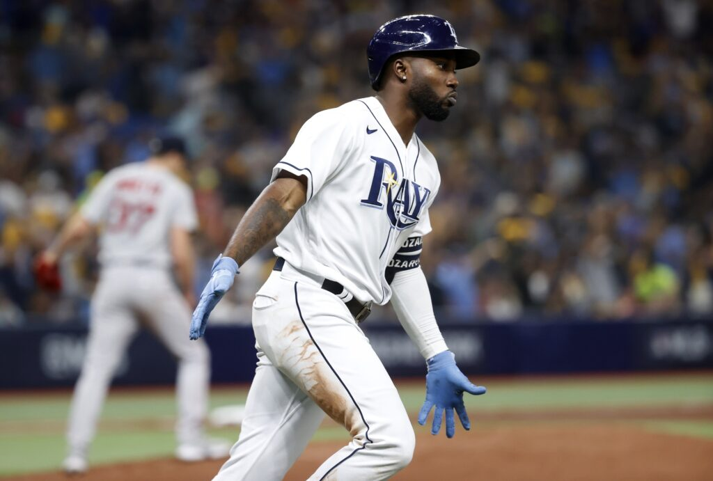 Oct 7, 2021; St. Petersburg, Florida, USA; Tampa Bay Rays right fielder Randy Arozarena (56) celebrates after hitting a home run during the 5th inning of game one of the 2021 ALDS against the Boston Red Sox at Tropicana Field. Mandatory Credit: Kim Klement-USA TODAY Sports