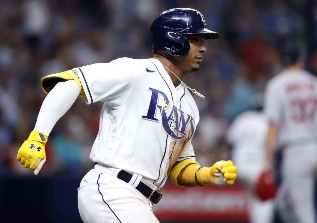 Oct 7, 2021; St. Petersburg, Florida, USA; Tampa Bay Rays shortstop Wander Franco (5) doubles during the 7th inning of game one of the 2021 ALDS against the Boston Red Sox at Tropicana Field. Mandatory Credit: Kim Klement-USA TODAY Sports