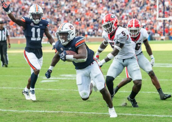 Auburn Tigers running back Tank Bigsby (4) crosses the goal line for a touchdown against Georgia at Jordan-Hare Stadium in Auburn, Ala., on Saturday, Oct. 9, 2021.