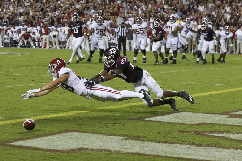 Oct 9, 2021; College Station, Texas, USA; Alabama Crimson Tide wide receiver Slade Bolden (18) drops a pass while being covered by Texas A&M Aggies defensive back Antonio Johnson (27) in the fourth quarter at Kyle Field. Mandatory Credit: Thomas Shea-USA TODAY Sports