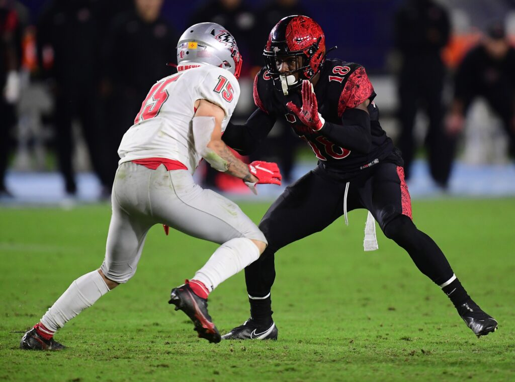 Oct 9, 2021; Carson, California, USA; San Diego State Aztecs safety Trenton Thompson (18) defends against New Mexico Lobos wide receiver Luke Wysong (15) during the second half at Dignity Health Sports Park. Mandatory Credit: Gary A. Vasquez-USA TODAY Sports