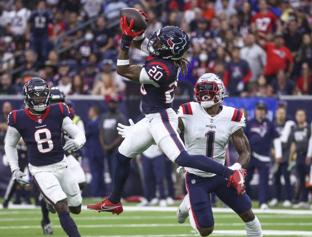 Oct 10, 2021; Houston, Texas, USA; Houston Texans safety Justin Reid (20) attempts to intercept a pass intended for New England Patriots wide receiver N'Keal Harry (1) during the fourth quarter at NRG Stadium. Mandatory Credit: Troy Taormina-USA TODAY Sports