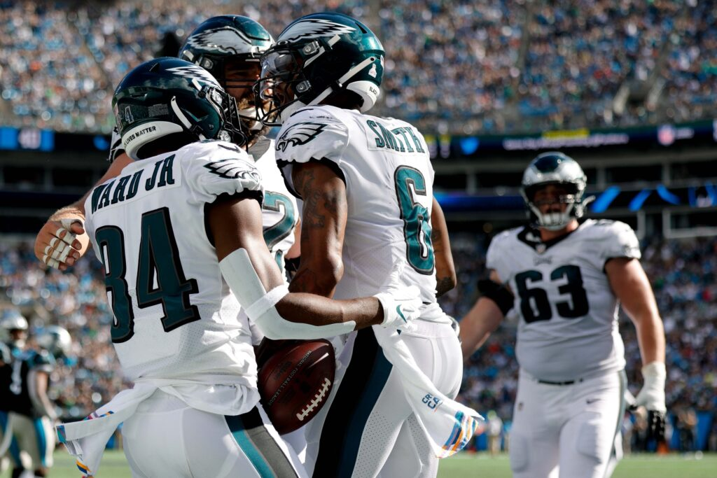 Oct 10, 2021; Charlotte, North Carolina, USA; Philadelphia Eagles wide receiver DeVonta Smith (6) celebrates with wide receiver Greg Ward (84) after scoring on a two point conversion during the second half against the Carolina Panthers at Bank of America Stadium. Mandatory Credit: Douglas DeFelice-USA TODAY Sports