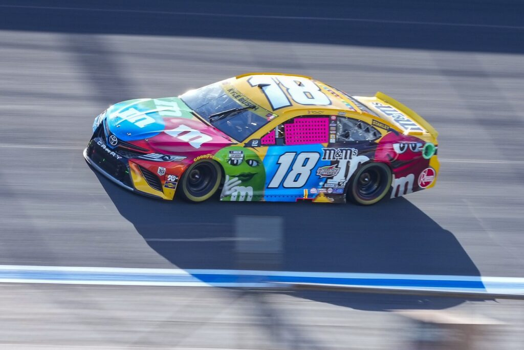 Oct 10, 2021; Concord, North Carolina, USA; NASCAR Cup Series driver Kyle Busch (18) on the banking during the Bank of America Roval 400 at Charlotte Motor Speedway Road Course. Mandatory Credit: Jim Dedmon-USA TODAY Sports