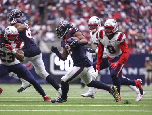 Oct 10, 2021; Houston, Texas, USA; Houston Texans running back Mark Ingram (2) runs with the ball during the third quarter against the New England Patriots at NRG Stadium. Mandatory Credit: Troy Taormina-USA TODAY Sports