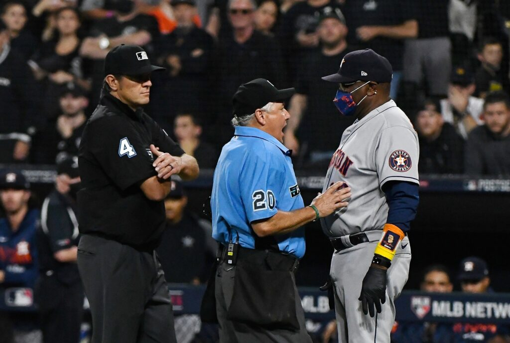 Oct 10, 2021; Chicago, Illinois, USA; Houston Astros manager Dusty Baker Jr. (12) talks tie umpire Tom Hallion (20) after a play at the plate during the fourth inning against the Chicago White Sox in game three of the 2021 ALDS at Guaranteed Rate Field. Mandatory Credit: Matt Marton-USA TODAY Sports