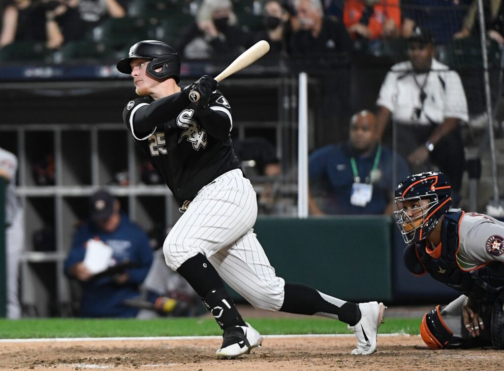 Oct 10, 2021; Chicago, Illinois, USA; Chicago White Sox pinch hitter Andrew Vaughn (25) hits a one run double against the Houston Astros during the eighth inning in game three of the 2021 ALDS at Guaranteed Rate Field. Mandatory Credit: Matt Marton-USA TODAY Sports