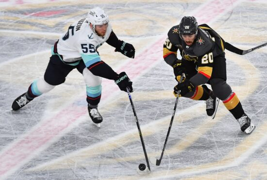 Oct 12, 2021; Las Vegas, Nevada, USA; Seattle Kraken defenseman Jeremy Lauzon (55) tips the puck away from Vegas Golden Knights center Chandler Stephenson (20) during the third period at T-Mobile Arena. Mandatory Credit: Stephen R. Sylvanie-USA TODAY Sports