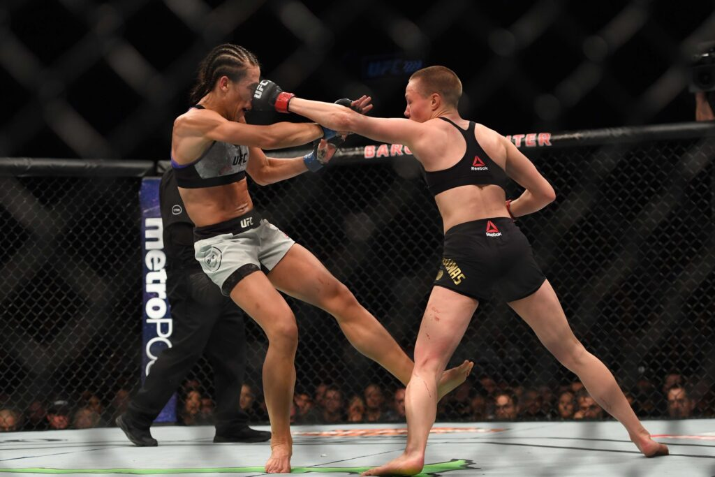 Apr 7, 2018; Brooklyn, NY, USA; Rose Namajunas (Red Gloves) fights Joanna Jedrzezjczyk (Blue gloves) during UFC 223 at Barclays Center. Mandatory Credit: Dennis Schneidler-USA TODAY Sports