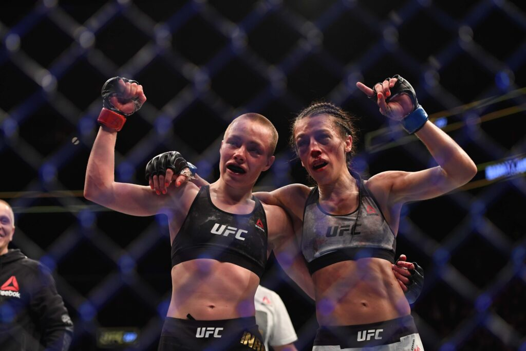 Apr 7, 2018; Brooklyn, NY, USA; Rose Namajunas (Red Gloves) and Joanna Jedrzezjczyk (Blue gloves) react to the fight during UFC 223 at Barclays Center. Mandatory Credit: Dennis Schneidler-USA TODAY Sports
