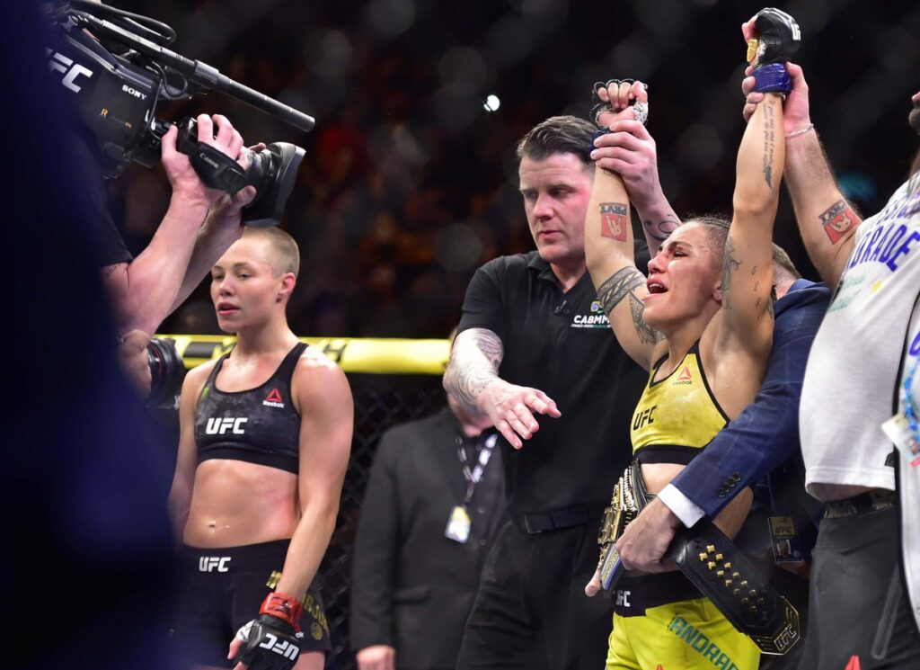 May 11, 2019; Rio de Janeiro, Brazil; Jessica Andrade (blue gloves) reacts to fight against Rose Namajunas (red gloves) during UFC 237 at Jeunesse Arena. Mandatory Credit: Jason Silva-USA TODAY Sports